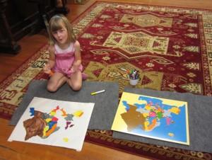 coloring her map of Europe