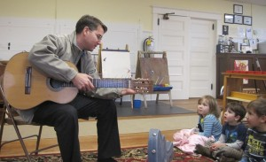 John playing the guitar
