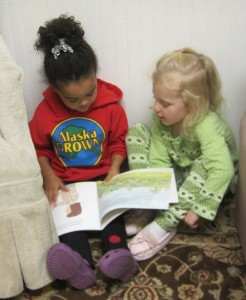 reading with a friend in a cozy hiding spot