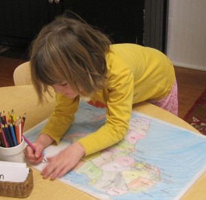 working hard on her map of Africa