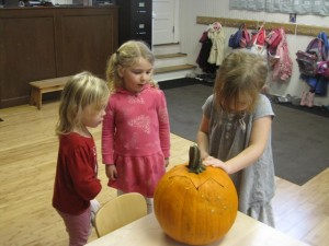 carving the last pumpkin
