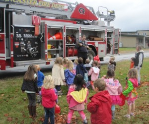 checking out the tools on the firetruck