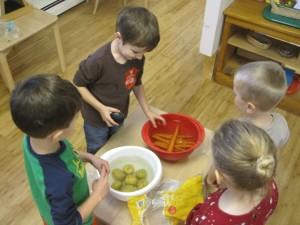 scrubbing potatoes