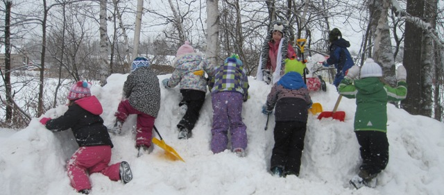 climbing the snow pile